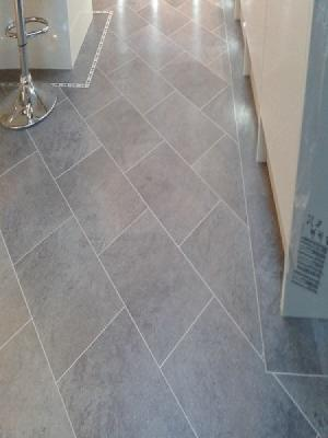 knight tiles cumbrian stone with dark mosiac border laid on the 45° laid by carpetstyle watford