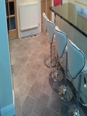 karndeans knight tiles cumbrian stone supplied and fitted by approved installers. design strips and mosiac border with tiles laid on the 45°