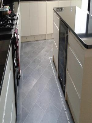 karndean professonialy installed to qualify for the warranty. using approved fitters. cumbrian stone knight tile