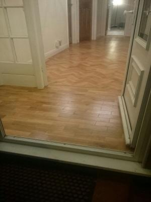 Karndean supplied and installed by registered fitters. art select blonde oak parquet herringbone design with a tram line border hallway and porch.