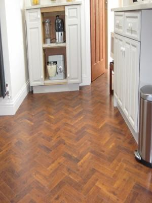 Carpetstyle Northwood Hills and Watford supplied and installed amtico signature priory oak herringbone laying pattern in Gerrads Cross