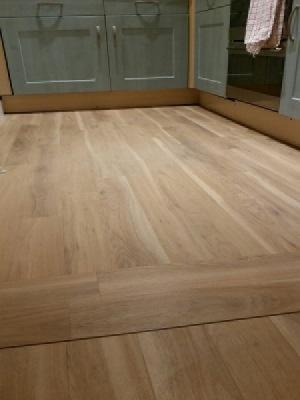 Amtico spacia eden oak with a pinstripe walnut border supplied by carpet style watfords only premium supplier with approved installers