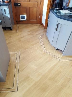 amtico golden oak signature laid on the 45° with a metro border supplied by carpet style and installed by our amtico approved installers