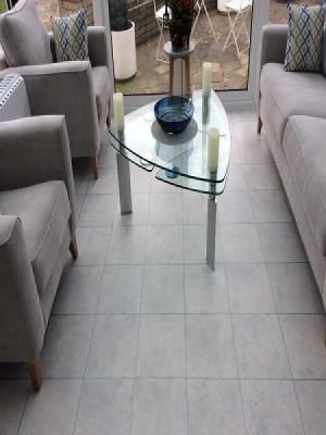 Amtico spacia ceramic frost 305mm x 305 mm with silver 3mm stripping. Supplied and installed by carpet style