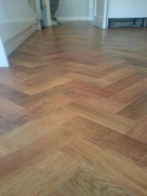 art select auburn oak herringbone parquet lvt laid by approved installers and a silver retailer